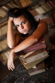 Long hair beauty lying on the book picture